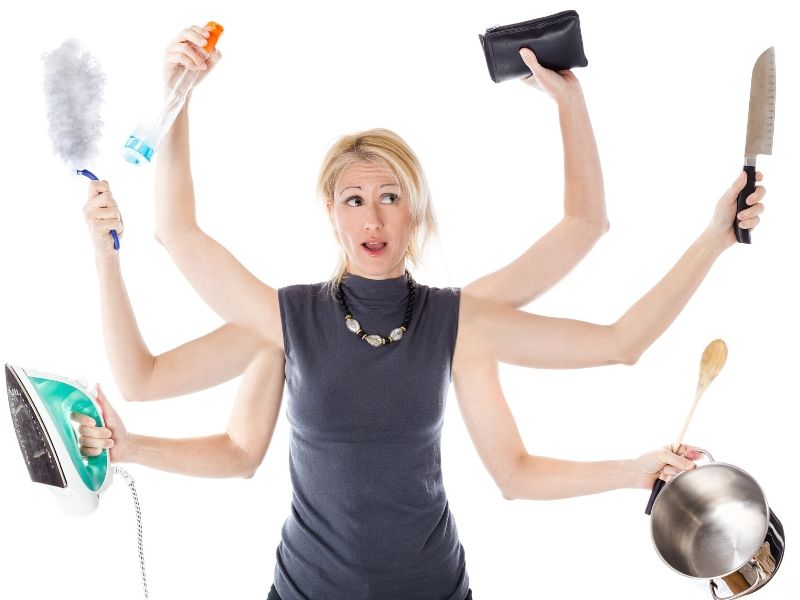 Photo of a busy mum in black top juggling all the things including cooking, cleaning, shopping and bills